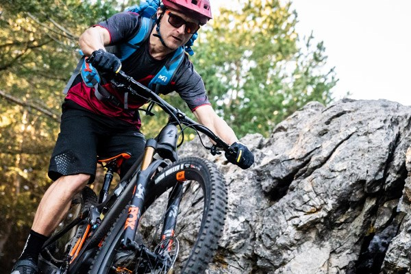 Cyclist riding a longer travel Enduro MTB
