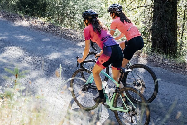 Two female cyclists wearing women-specific bib shorts
