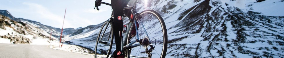 A cyclist in bib shorts in a cold winter scence