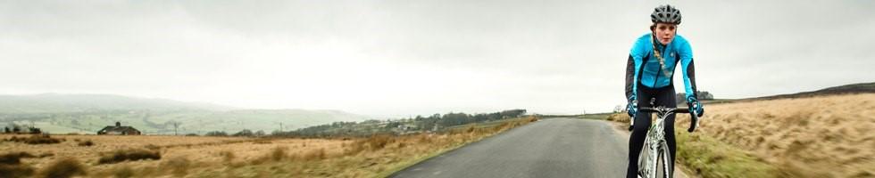 Female cyclist wearing blue cycling jacket