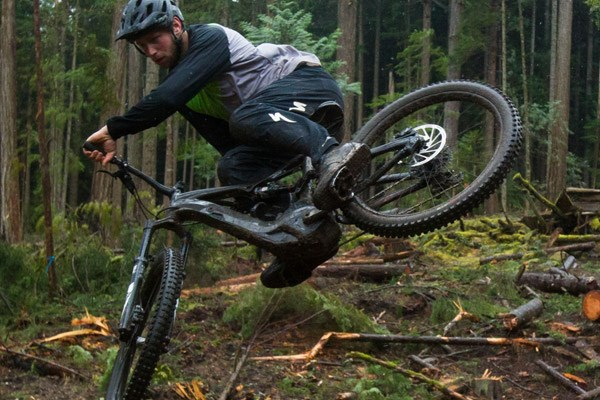 A mountain biker wearing stretchy DH trousers while whipping