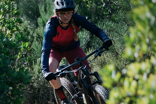 A mountain biker wearing a long sleeve jersey