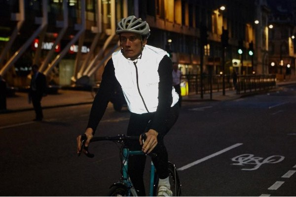 A reflective gilet worn over a non-reflective jacket helps make the cyclist much more visible