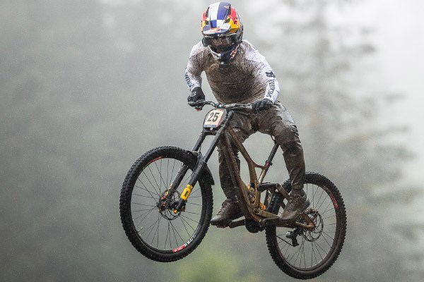 Downhill rider wearing MTB waterproof trousers