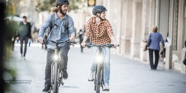 Cyclists riding through a city