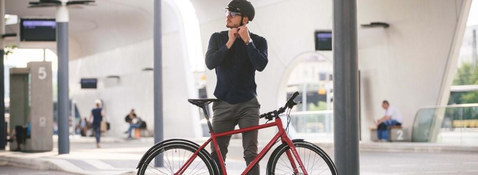 Cyclist putting on a bike helmet