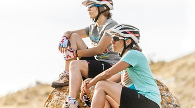Two women cyclists taking a relaxing break from their ride