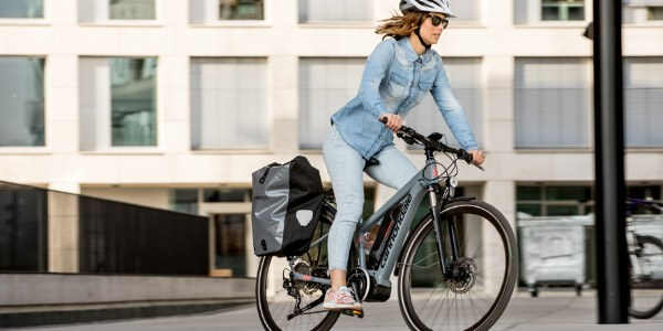 Female cyclist on a electric mountain bike in urban setting