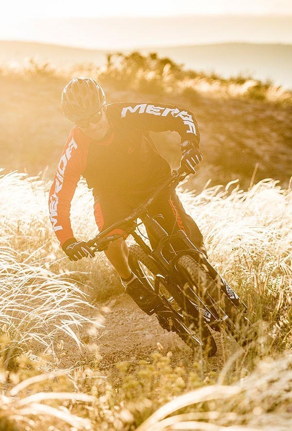 Merida mountain biker on sunset trail
