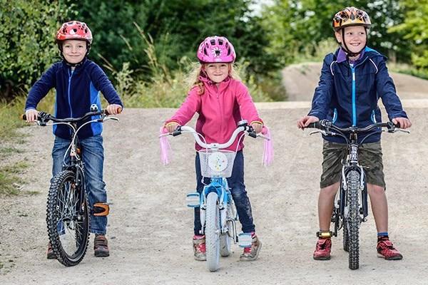Kids on various size bikes
