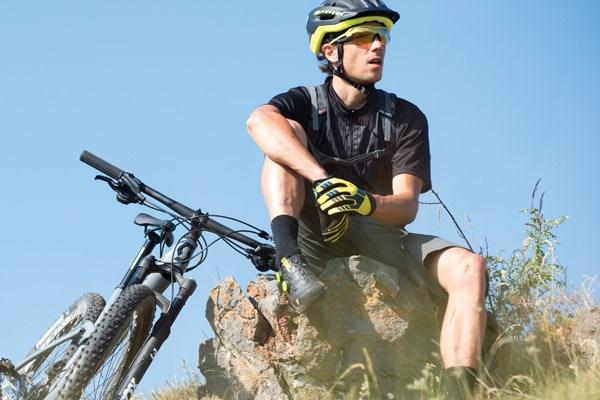 Mountain biker sitting next to Scott MTB