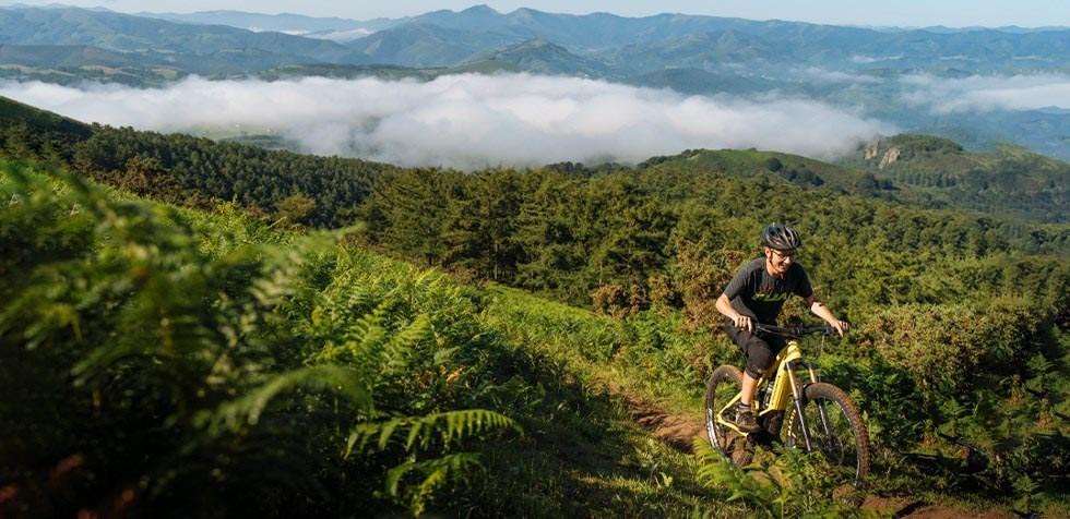 MTB rider climbing on Orbea Wild FS in Spain
