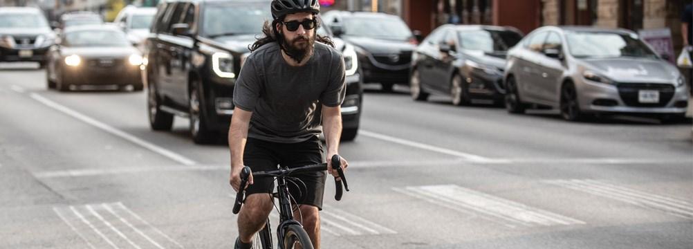 A commuter riding amongst city traffic
