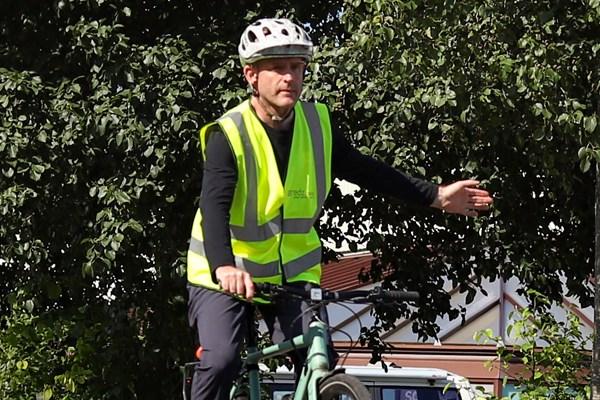 Cyclist using a left turn signal
