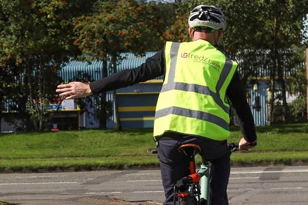 Cyclist signalling a left turn