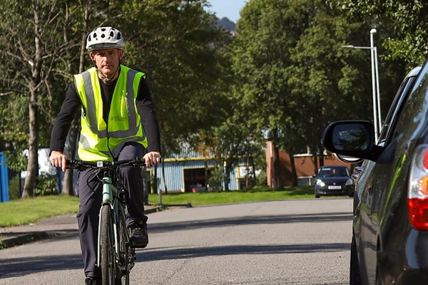 Cyclist passing a parked car