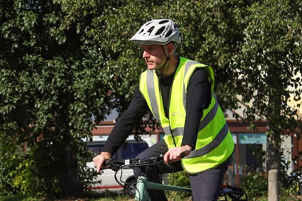 Cyclist riding along on a sunny day