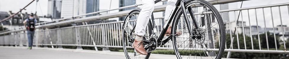 Hybrid cyclist riding in ubran environment