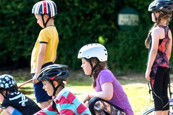 Kids wearing bike helmets