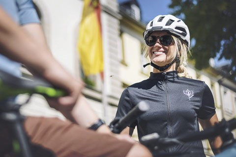 Female cyclist wearing a jersey