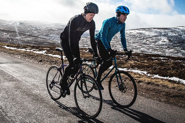 two road cyclists in winter