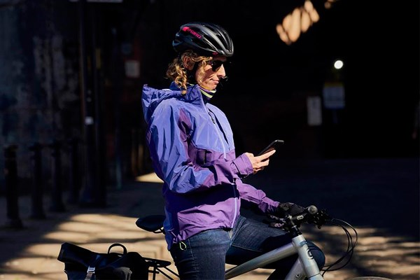Cyclist checking phone