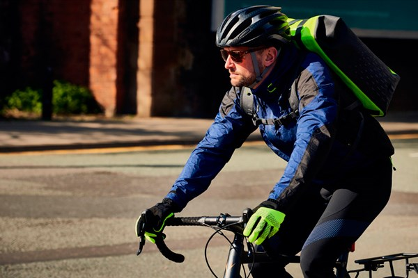 A commuter dressed for winter cycling