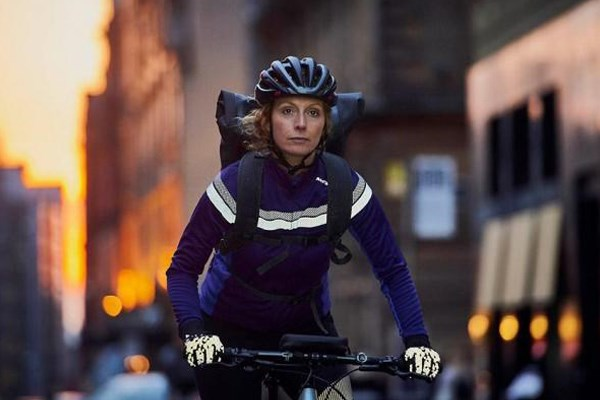 female cyclist riding in the city