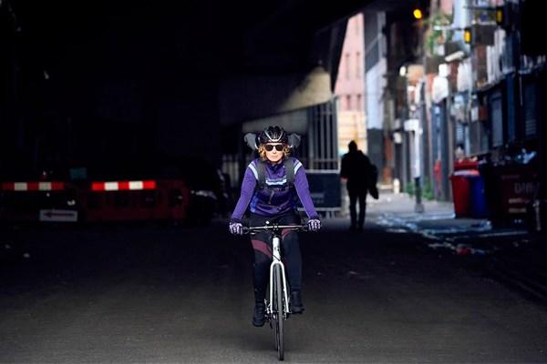 Female cycling through city