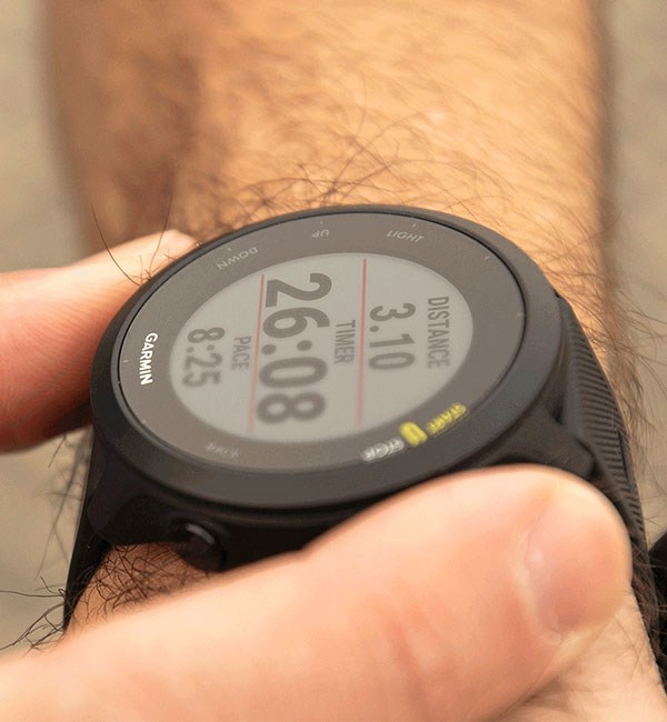 Garmin Forerunner 55 watch face showing distance, time and pace