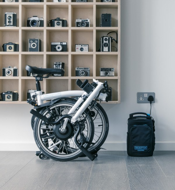 Brompton Electric bike folded with battery charging