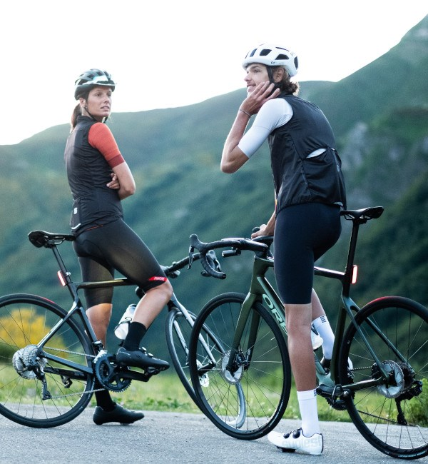 two cyclists having a break on their Orbea Orcas