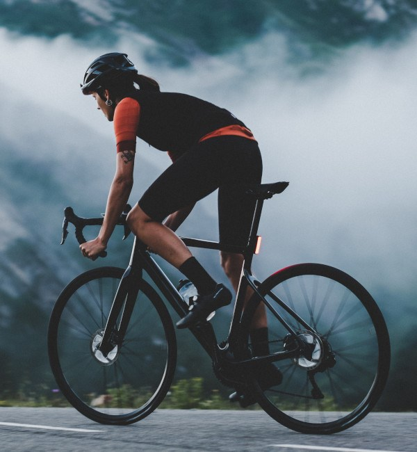 woman cyclist riding orbea orca