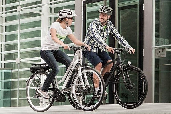 commuter couple riding an e bike