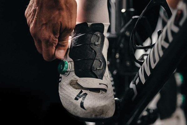adjusting the BOA dial on road bike shoes