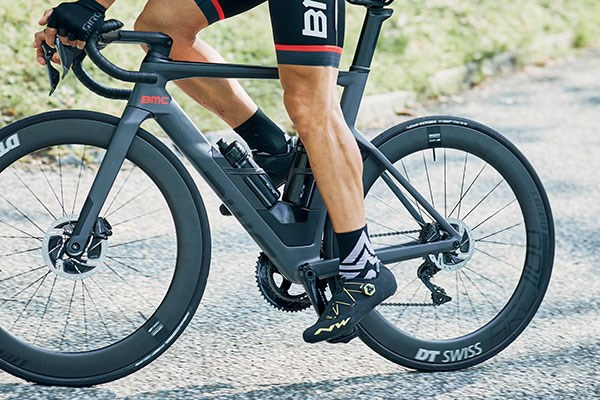 Road cyclist ridng a BMC showing off shoes