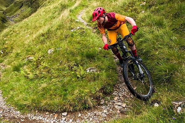 Mountainbiker riding a switch back turn