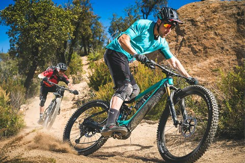 Mountain bikers on dusty trail