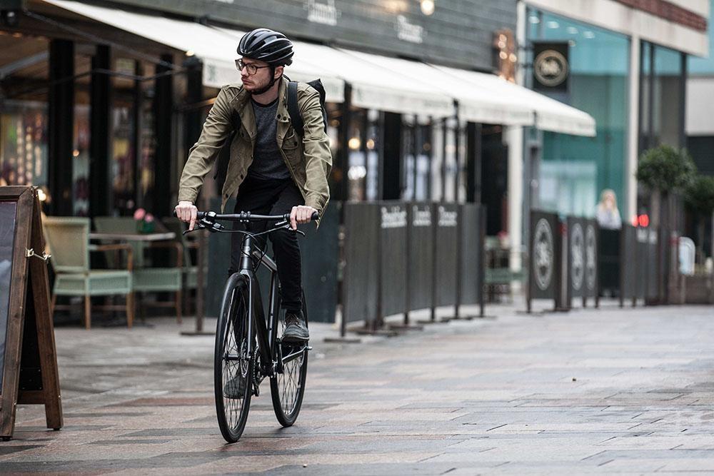 commuter riding through city