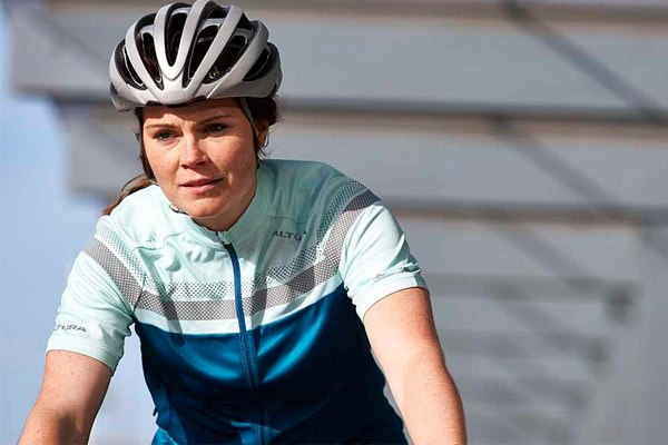 female cyclist wearing a helmet