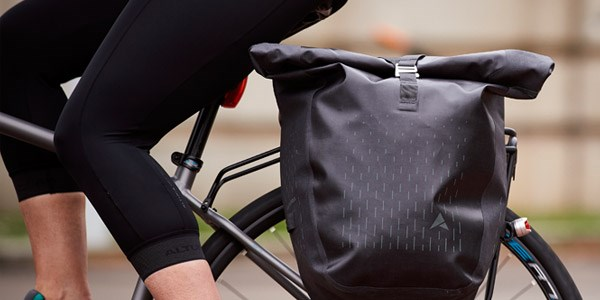 A cycle commuter uses Altura waterproof panniers to keep their work essentials dry