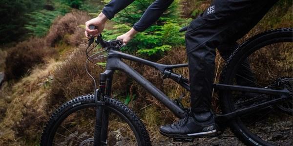 A mountain biker wearing waterproof trousers