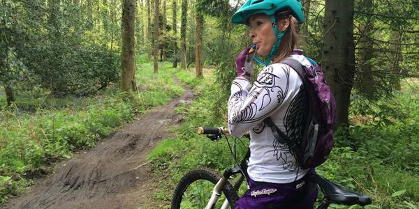 A mountain biker uses a hydration pack