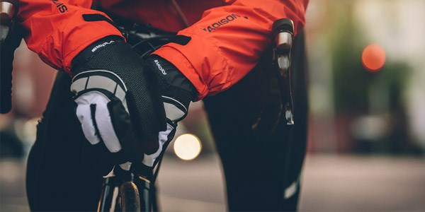 A road cyclist wearing long finger gloves