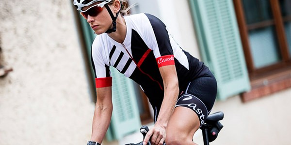 A female road cyclist wearing summer cycle clothing.