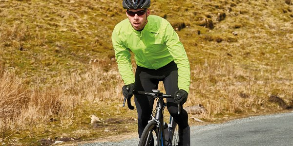 A road cylist wearing winter clothing.