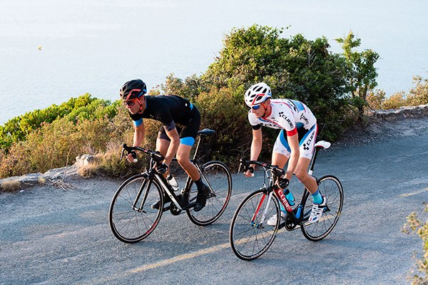Two cyclists riding cube road bikes
