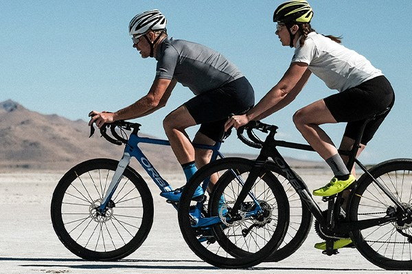 Two cyclists riding endurance road bikes