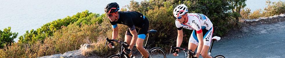 Two cyclist riding endurance road bikes through the desert
