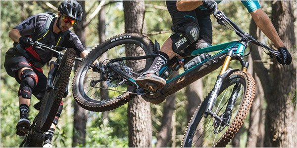 Merida eOne-Sixty 2020s being ridden over jumps